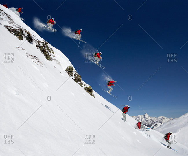 Sequence of male skier jumping down