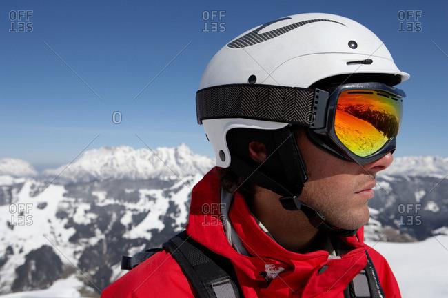 Male skier wearing helmet