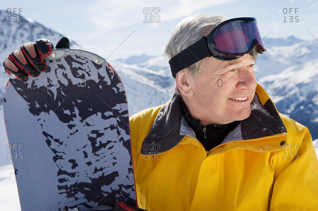 Mature male snowboarder on mountain