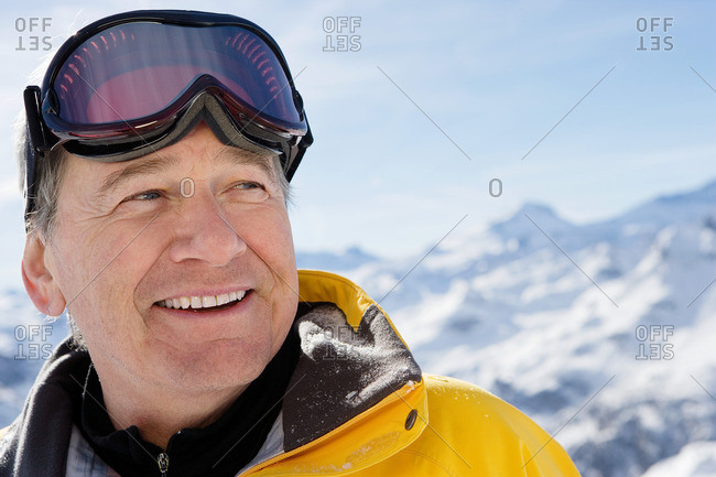 Mature male in ski-wear on mountain