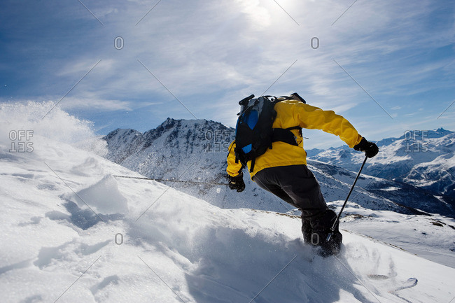 Male skiing on mountain rear view