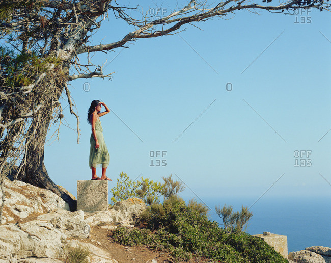 Woman standing on a large rock