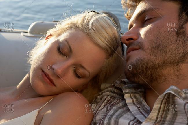 Couple sleeping in a raft
