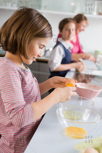 Girl separating egg yolk and egg white