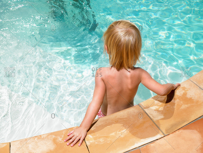 Young boy at ledge of pool