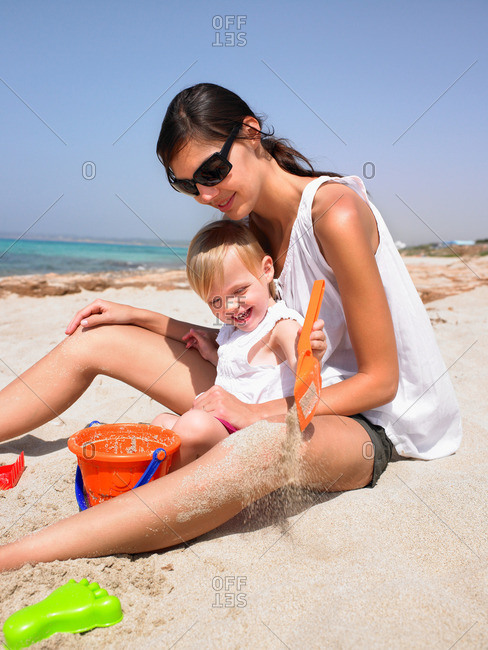 Woman and young girl at the beach