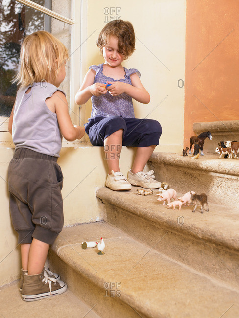 Little girls with plastic animals