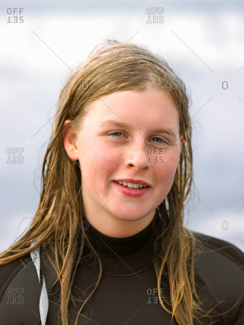 Portrait of female surfer with wet hair