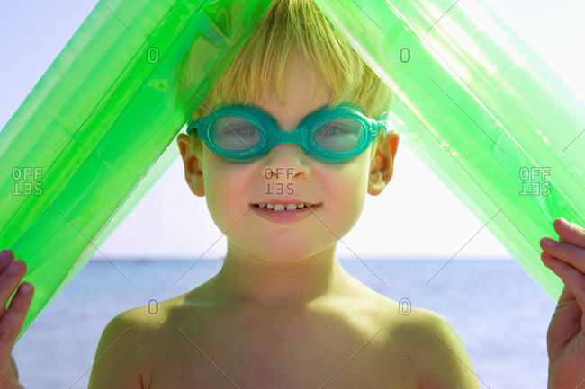 Young boy wearing swim goggles