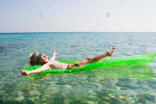Young boy on an inflatable raft