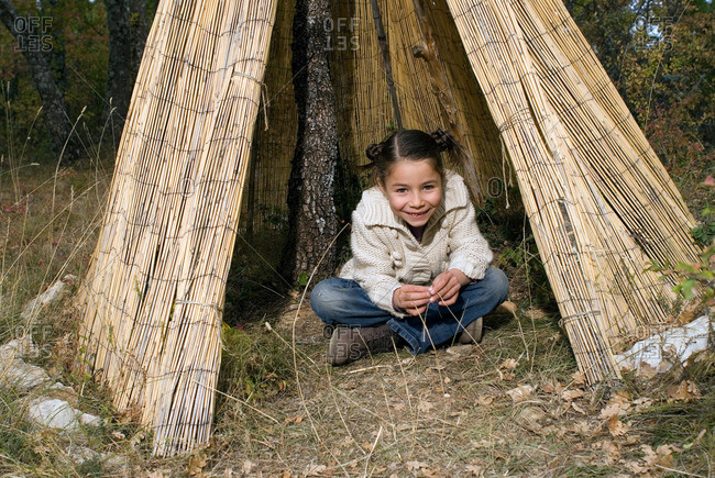 5-7 years old kids playing in a tipi
