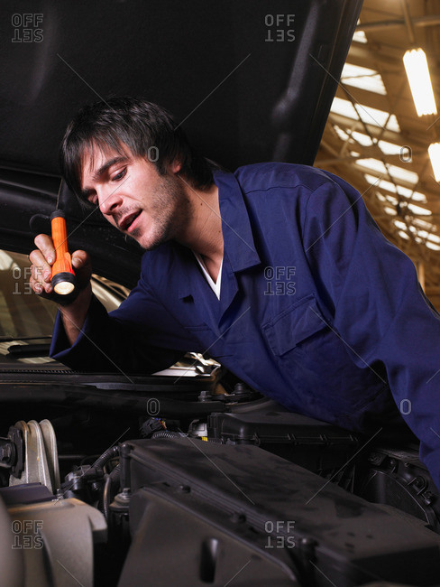 Mechanic working on an engine