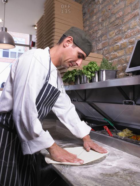 Pizza chef preparing pizza dough