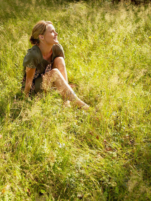 Woman sitting in the grass smiling