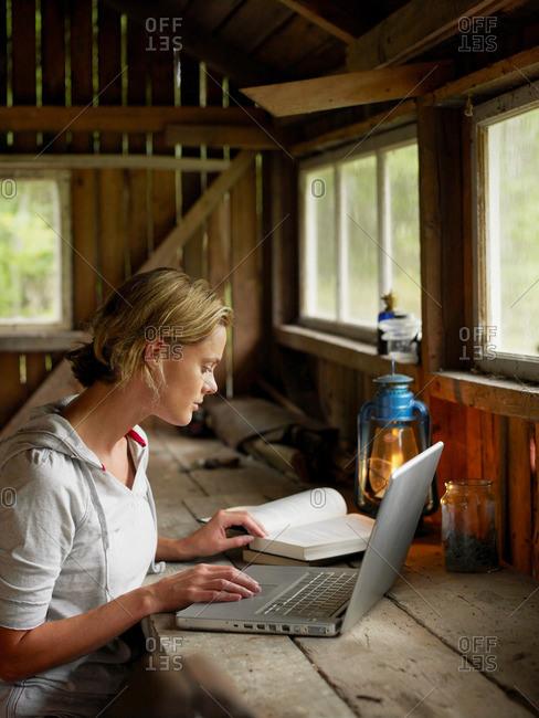 Woman with laptop and mug