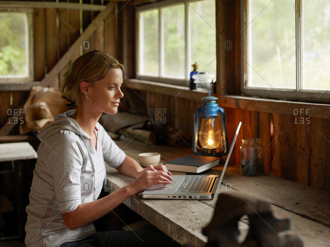 Woman with laptop and mug