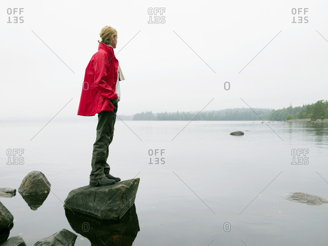 Woman standing on large rock