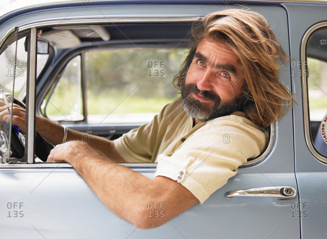 Mature man driving car