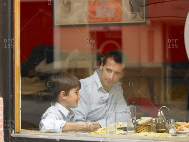 Father and son dining in Cafe�