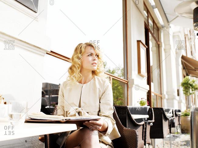 Woman at an outdoor restaurant