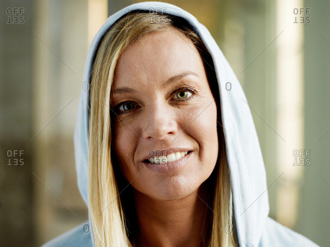 Woman wearing hooded top smiling