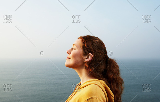 Profile of a young Woman by the sea
