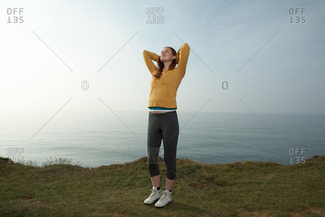 A young Woman stretching in a seascape
