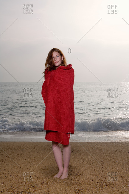 Woman with a towel on the beach