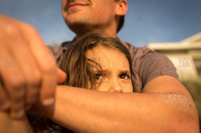 Father with his arm around his little girl