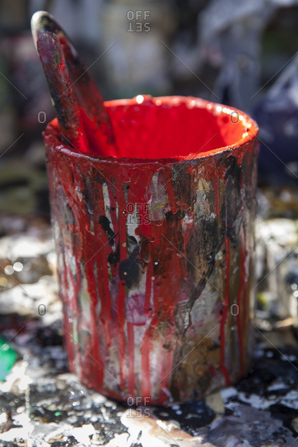 Red paint can with paint splattered