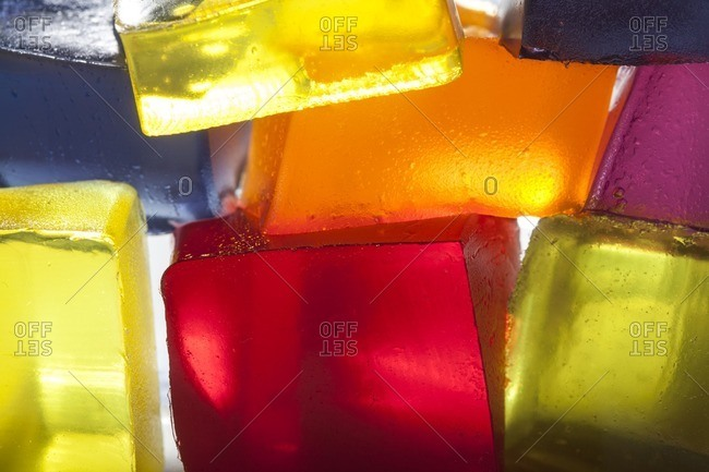 Translucent blocks of stacked, colored gelatin lit from behind
