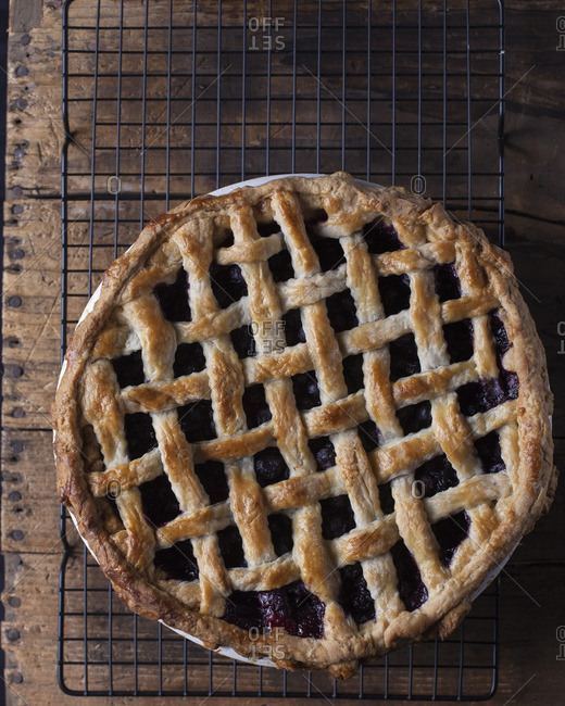 Blueberry pie with lattice crust on rustic wood