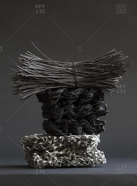 Still life of three types of dried Asian noodles