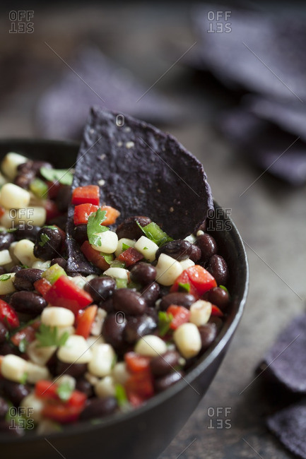 Black and white bean dip with black tortilla chips