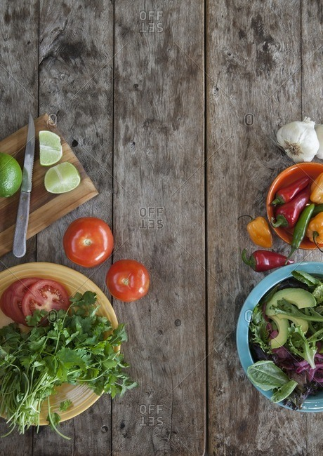 Overhead view of southwestern salad ingredients on wooden background