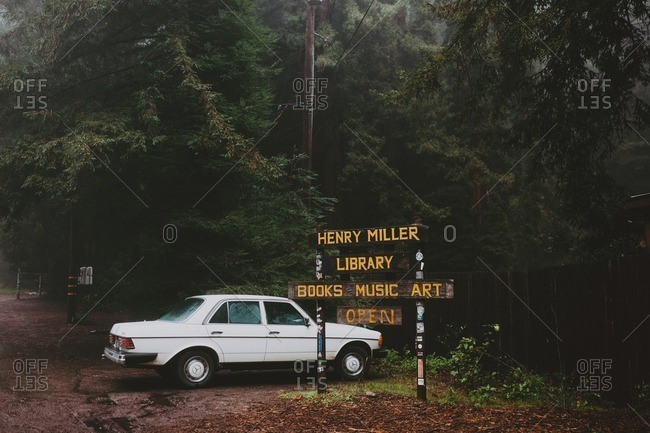 December 6, 2016 - Big Sur, California: Car parked by sign to Henry Miller Library