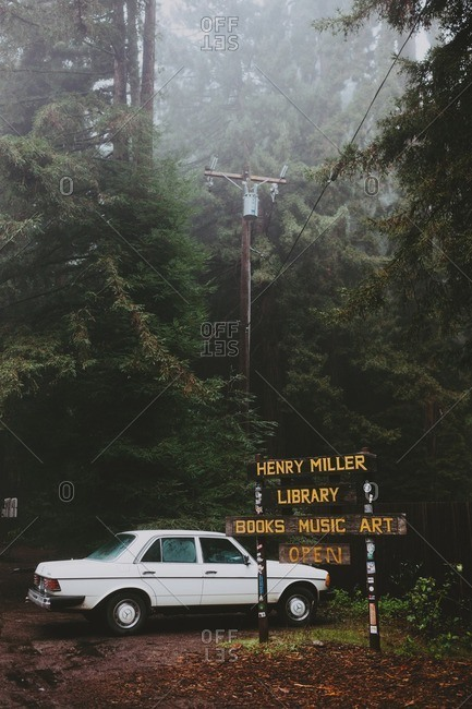 December 6, 2016 - Big Sur, California: Car parked by Henry Miller Library sign