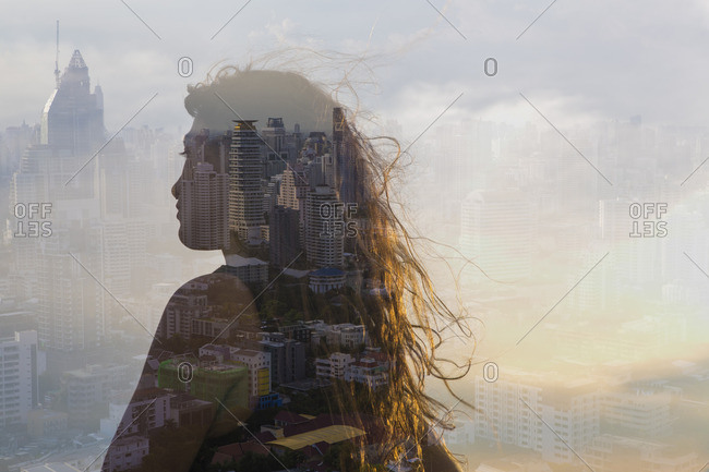 Back view of woman looking out over a cityscape