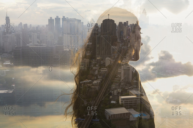 Woman with long hair overlooking a cityscape