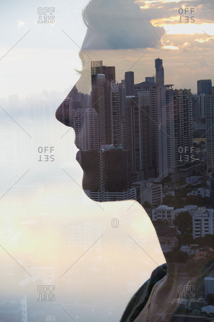 Silhouette of man overlooking a cityscape