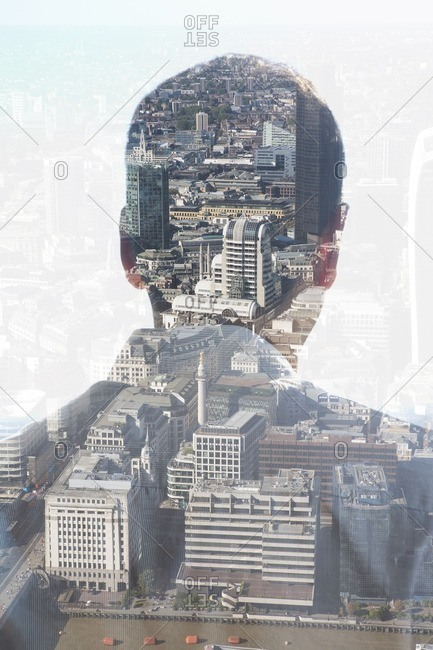 Back view of man overlooking a city scene