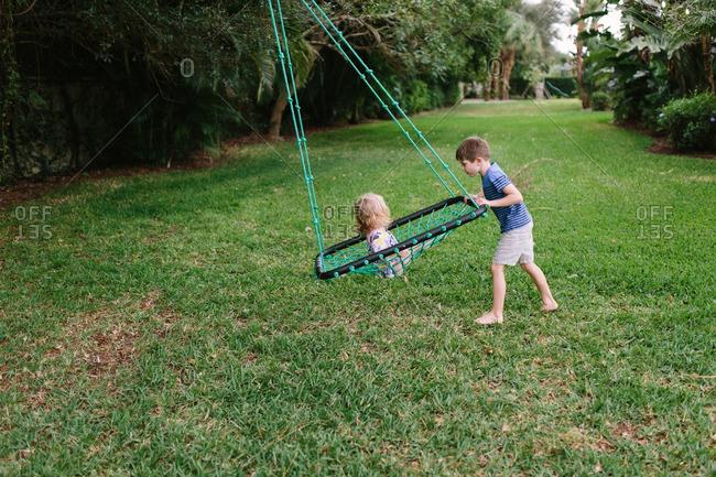 Children playing in backyard swing