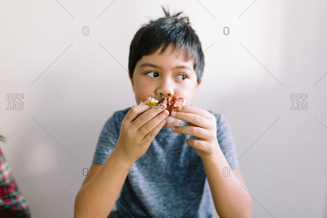 Young asian boy eating breakfast