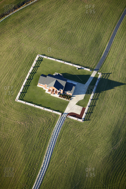 Aerial view of  a house surrounded by a square fence just off the threshold at Shiflett Field in Marion NC