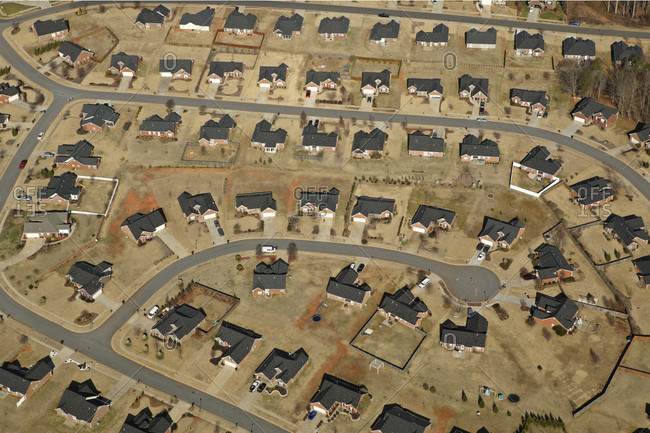 An aerial view of a tree-less and grid-like planned suburban community in Greenville, SC.