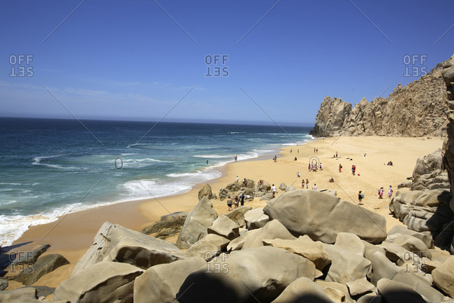 Baja, Mexico - May 30, 2006: Beachgoers enjoying the day at Divorce Beach near El Arco in Cabo San Lucas