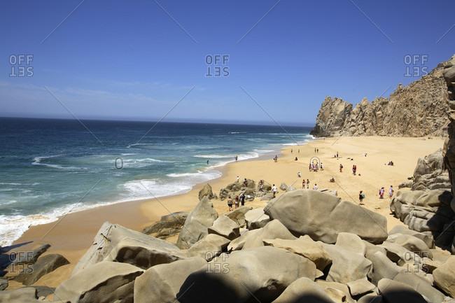 Baja, Mexico - May 30, 2006: Beachgoers enjoying the day at Divorce Beach near El Arco in Cabo San Lucas