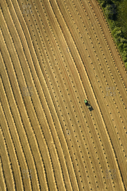 Aerial view of a farmer haying his field near Hendersonville, NC.