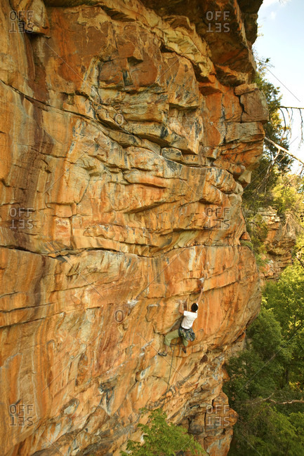 Man nabs the first free ascent at the far left end of the Tennessee Wall outside of Chattanooga, TN.
