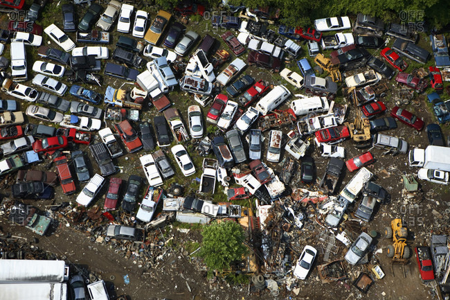 Aerial view of an auto scrapyard along the French Broad River near Brevard, NC